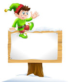 Elf on Snowy Sign — Stock Vector