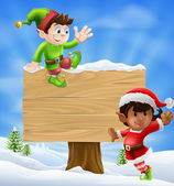 Christmas Elves and Sign — Stock Vector