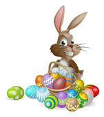 Easter bunny rabbit with Easter eggs basket — Stock Vector