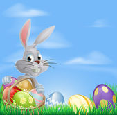Easter eggs bunny in field — Stock Vector