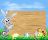 Easter bunny and sign — Stock Vector
