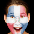 Girl with Dominican Republic flag on her face — Stock Photo #19671749