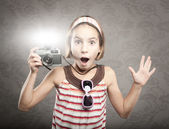 Little girl holding a vintage camera — Stock Photo