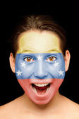 Girl with venezuelan flag on her face — Stock Photo