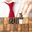 Businessman hand building year 2013 — Stock Photo #19706059