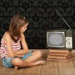Girl watching old tv — Foto Stock