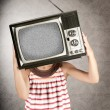 Girl with television on her head — Stock Photo