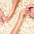 Two girls buried in popcorn — Stock Photo #19709201