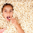 Little girl buried in popcorn — Stock Photo #19709265