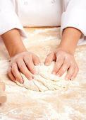 Chef working the dough — Stock Photo