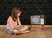 Girl watching old tv — Stock Photo