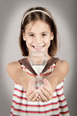 Little girl holding an hourglass — Stock Photo