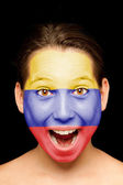 Girl with colombian flag on her face — Stock Photo