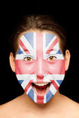 Girl with british flag painted on her face — Stock Photo
