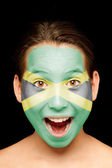 Girl with jamaican flag painted on her face — Stock Photo