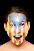 Girl with catalan pro-independence flag painted on her face — Stock Photo