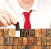 Businessman building team word — Stock Photo