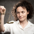 Stock Photo: Holding justice scale