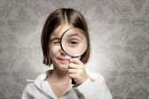 Looking at camera through magnifying glass — Stock Photo