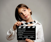 Mädchen mit movie clapper board — Stockfoto