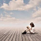 Little girl reading a book — Stockfoto