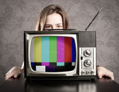 Woman with old retro tv — Stock Photo
