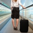 Businesswoman with a suitcase — Stock Photo