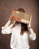 Woman with old retro radio — Stock Photo