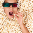 Little girl buried in popcorn — Stok fotoğraf
