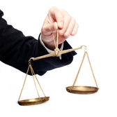Hand holding a balance — Stock Photo