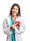 Young doctor holding a heart — Stock Photo