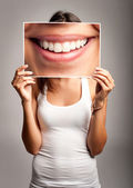 Young woman holding a smile — Stock Photo