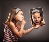 Little girl showing silence gesture — Stock Photo
