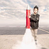 Little aviator holding a rocket — Stock Photo