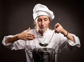Woman chef cooking — Stock Photo