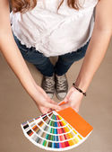 Woman with pantone palette — Stock Photo