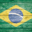 Brazilian flag on wood — Stock Photo