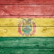 Bolivian flag on wood — Stock Photo