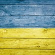 Ukrainian flag on wood — Stock Photo