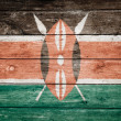 Kenya flag on wood — Stock Photo