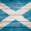 Stock Photo: Scottish flag on wood