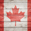 Canadian flag on wood — Stock Photo