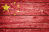 Chinese flag on wood — Stockfoto