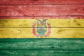Bolivian flag on wood — Stock Photo