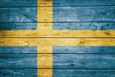 Swedish flag on wood texture — Stock Photo