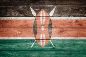 Kenya flag on wood — Stock Photo