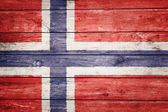 Norwegian flag on wood — Stock Photo