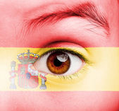 Girl with spanish flag painted — Stock Photo
