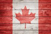 Canadian flag on wood — Stock Photo