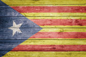 Catalan pro-independence flag on wood — Stock Photo